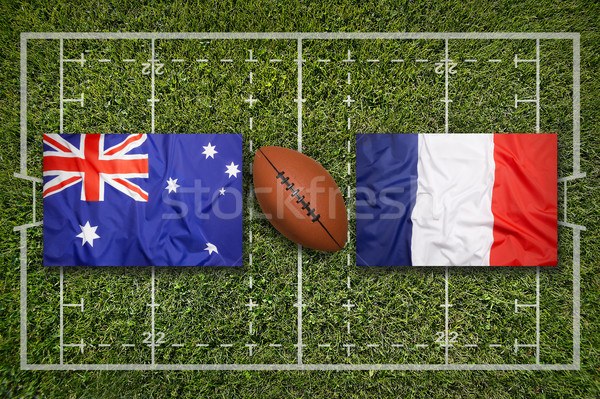 Stock photo: Australia vs. France flags on rugby field