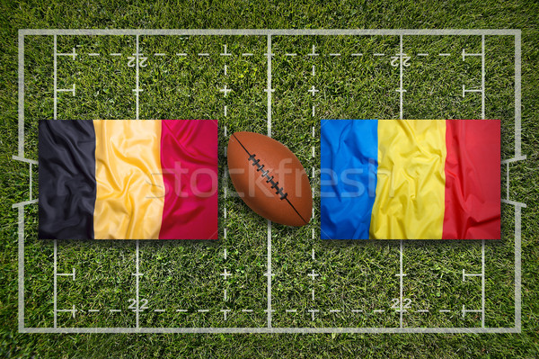 Stock photo: Belgium vs. Romania flags on rugby field