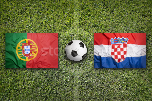 Portugal vs. Croatia flags on soccer field Stock photo © kb-photodesign