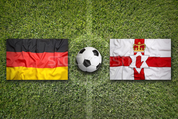 Germany vs. Northern Ireland flags on soccer field Stock photo © kb-photodesign