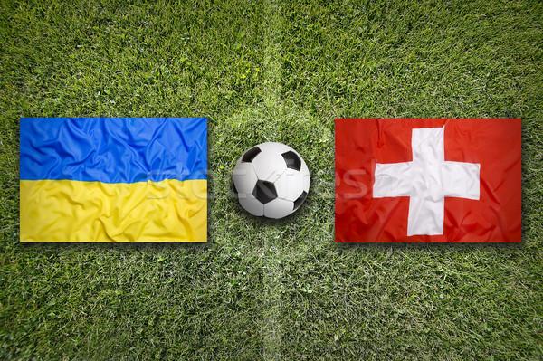 Ukrajna vs Svájc zászlók futballpálya zöld Stock fotó © kb-photodesign
