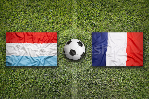 Luxembourg vs. France flags on soccer field Stock photo © kb-photodesign