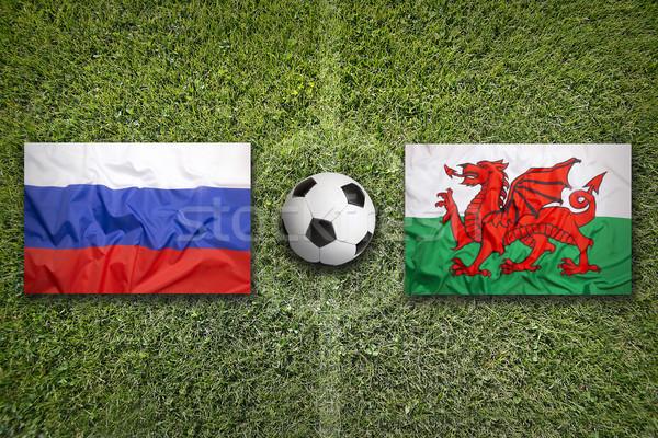 Россия против Уэльс флагами футбольное поле зеленый Сток-фото © kb-photodesign