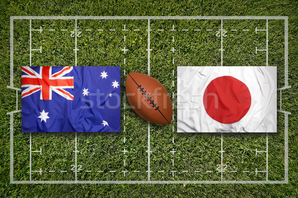 Stock photo: Australia vs. Japan flags on rugby field