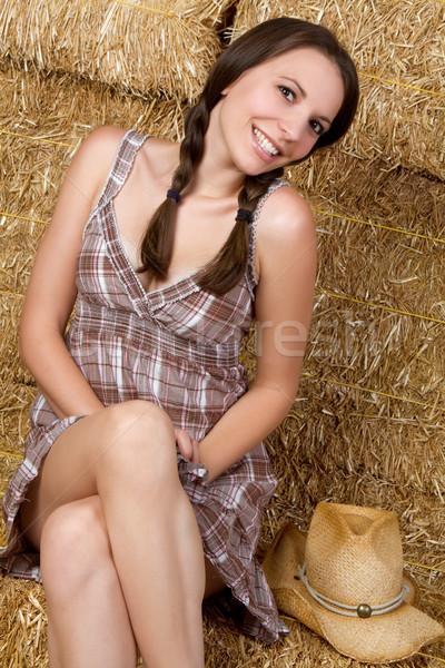 ülke kız oturma saman kız bacaklar genç Stok fotoğraf © keeweeboy