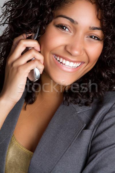 Cellulare donna sorridente donna nera occhi telefono capelli Foto d'archivio © keeweeboy