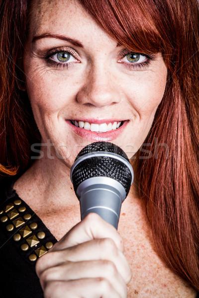 Smiling Singing Woman Stock photo © keeweeboy