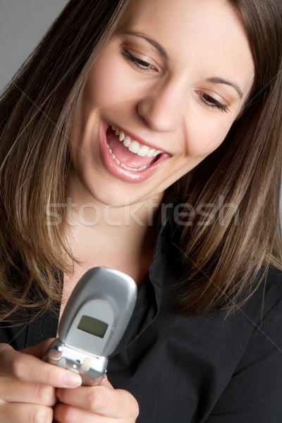 Lány sms üzenetküldés telefon ír mobil beszél Stock fotó © keeweeboy