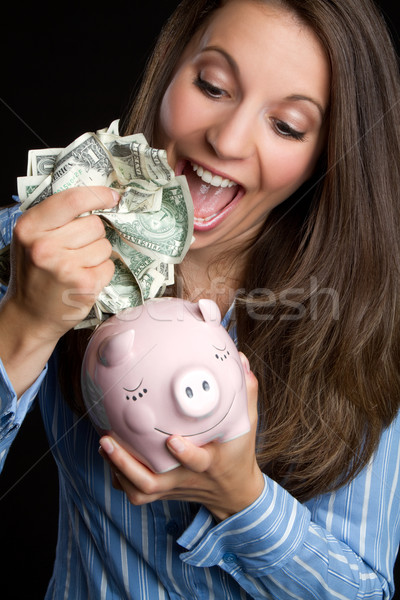 Woman Saving Money Stock photo © keeweeboy