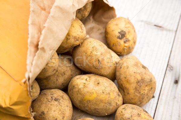 Worek rustykalny ziemniaki brudne biały brud Zdjęcia stock © keeweeboy