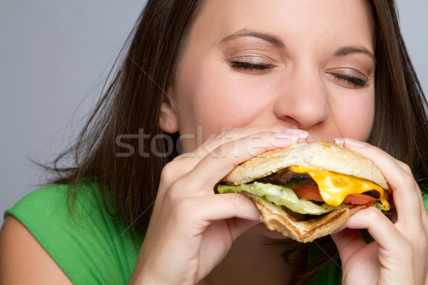 Fille manger alimentaire belle fille hamburger mains Photo stock © keeweeboy