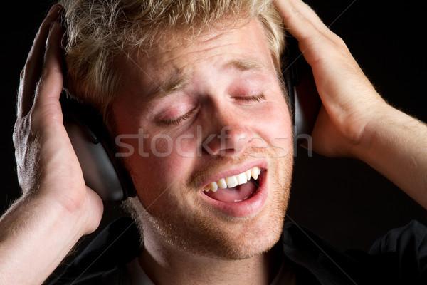 Zdjęcia stock: Słuchawki · muzyki · człowiek · słuchania · szczęśliwy · oczy