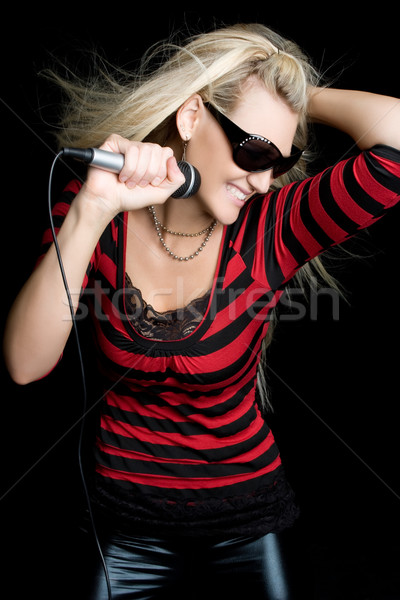 Rock star dziewczyna dość blond śpiewu kobieta Zdjęcia stock © keeweeboy