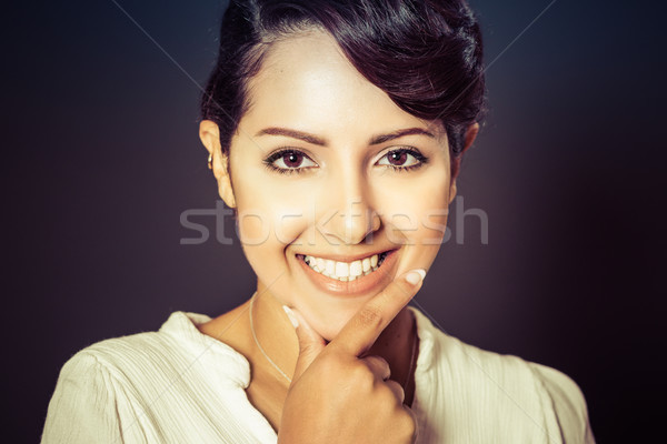 Stock photo: Thinking Smiling Woman