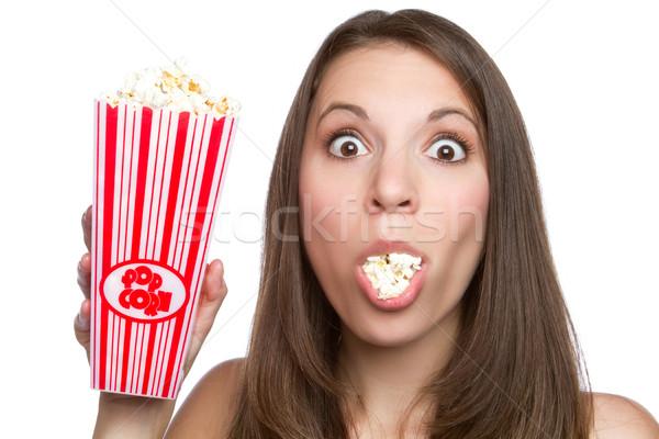 Lány eszik pattogatott kukorica gyönyörű fiatal lány étel Stock fotó © keeweeboy