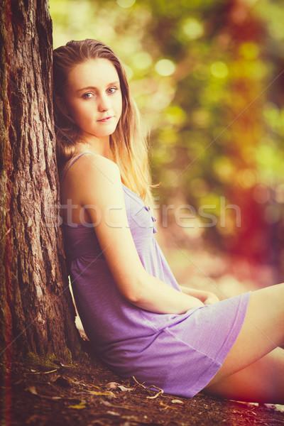 Girl Sitting by Tree Stock photo © keeweeboy