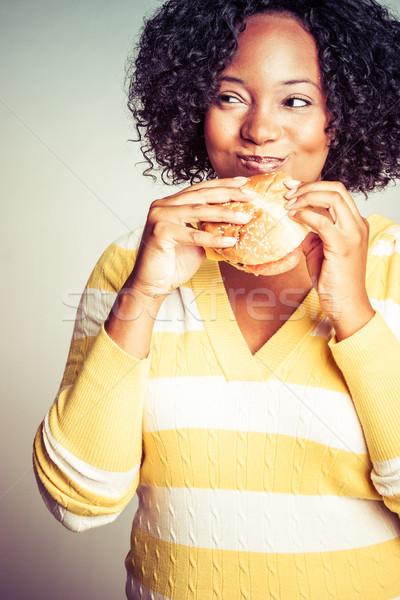 Woman Eating Sandwich Stock photo © keeweeboy