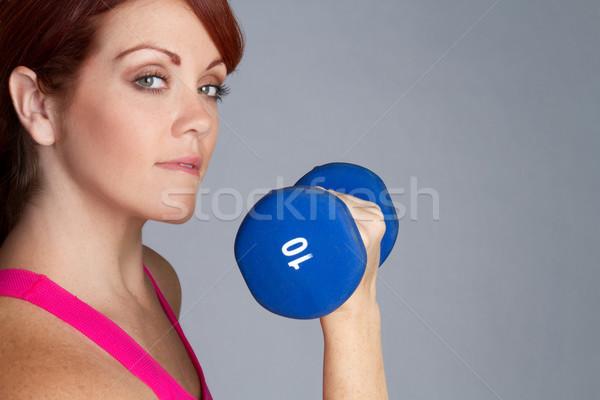 Nő emel súlyok csinos vörös hajú nő fitnessz Stock fotó © keeweeboy