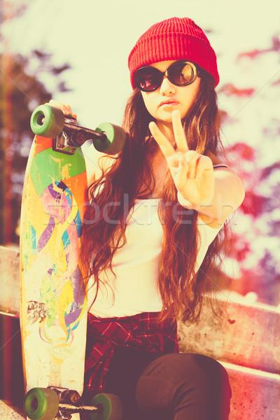 мира фигурист девушки знак стороны очки Сток-фото © keeweeboy