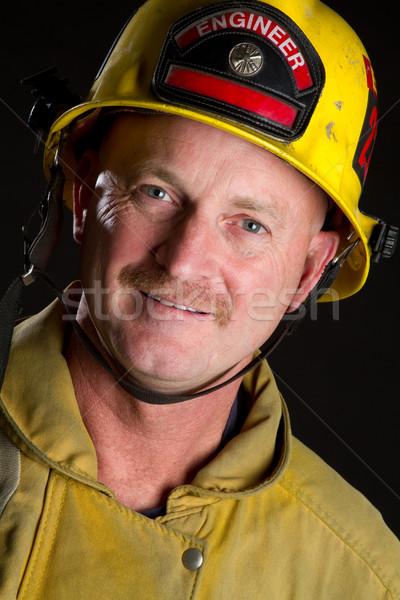 笑みを浮かべて 消防 着用 ヘルメット 男 背景 ストックフォト © keeweeboy