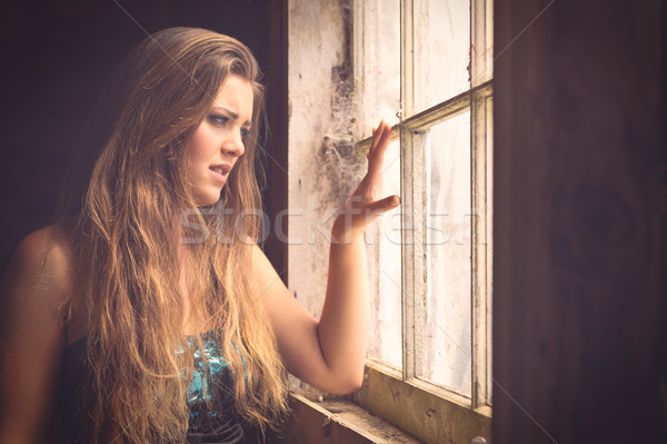 WOman Looking out Window Stock photo © keeweeboy