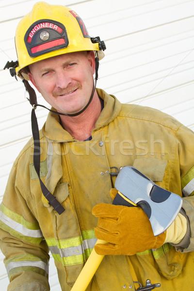 Pompiere ax sorridere uomo sfondo Foto d'archivio © keeweeboy