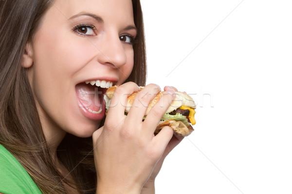 Femme manger hamburger belle jeune femme alimentaire Photo stock © keeweeboy