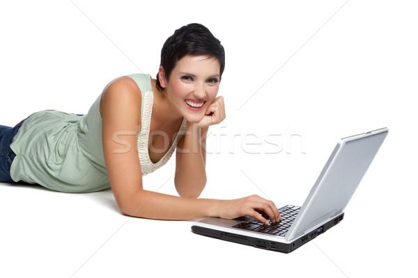 Computer portatile donna sorridente isolato donna computer internet Foto d'archivio © keeweeboy