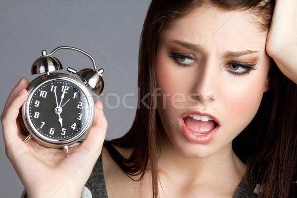 çalar saat kadın rahatsız yüz saat Stok fotoğraf © keeweeboy