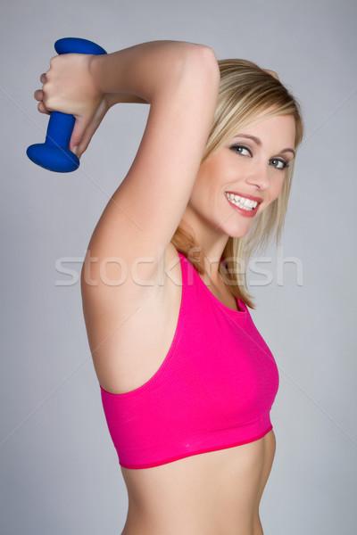 Súlyemelés nő testmozgás fitnessz sportok fekete Stock fotó © keeweeboy