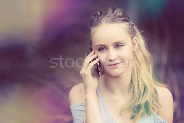 Blond Girl on Phone Stock photo © keeweeboy