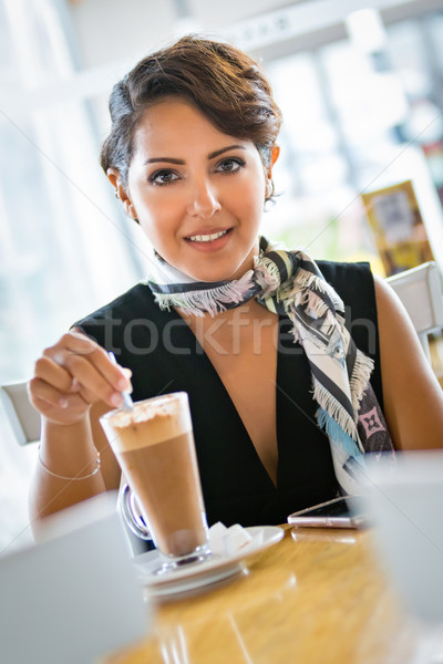 Woman Stirring Coffee Stock photo © keeweeboy
