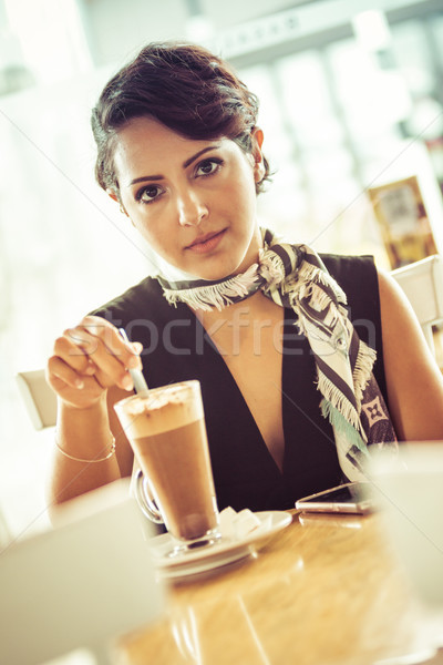 Woman Stirring Coffee Drink Stock photo © keeweeboy