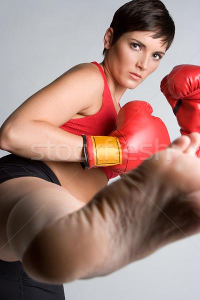 Calci donna bella kickboxing gambe Foto d'archivio © keeweeboy