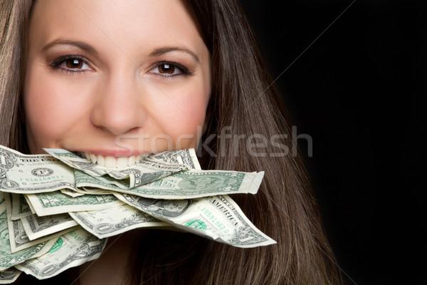 Para kadın güzel bir kadın yeme nakit yüz Stok fotoğraf © keeweeboy