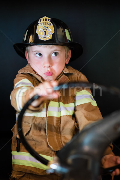 Boy Driving Fire Truck Stock photo © keeweeboy