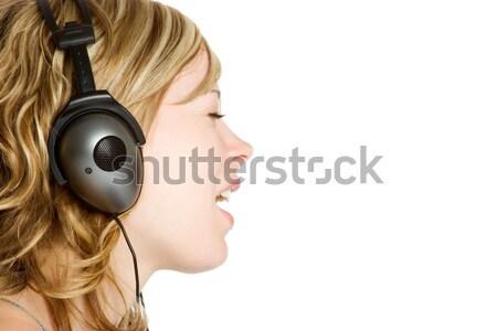 Fones de ouvido música menina sorridente escuta cara Foto stock © keeweeboy