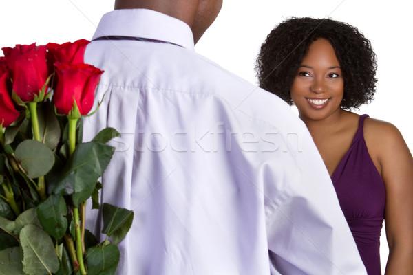 Stock fotó: Romantikus · pár · fekete · tart · rózsák · mosoly