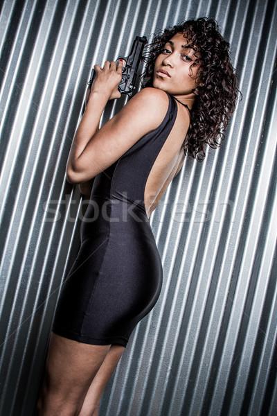 Fekete ruha fegyver nő tart visel lány Stock fotó © keeweeboy