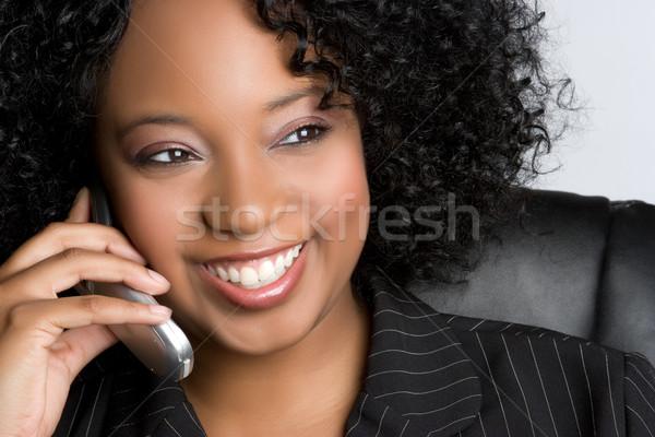 Telefono donna sorridente nero cellulare donna business Foto d'archivio © keeweeboy
