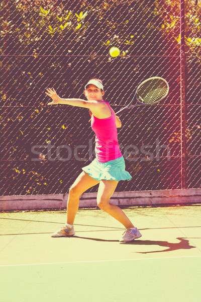 Young Woman Playing Tennis Stock photo © keeweeboy