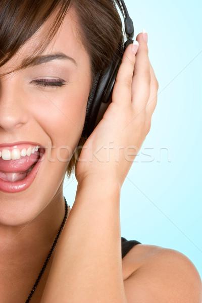 Kulaklık kız şarkı söyleme güzellik uzay Stok fotoğraf © keeweeboy
