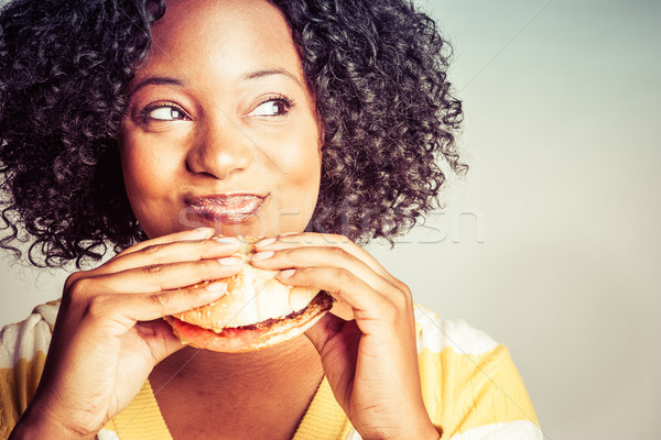 Woman Eating Hamburger Stock photo © keeweeboy
