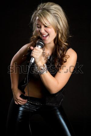 Woman Singing into Microphone Stock photo © keeweeboy