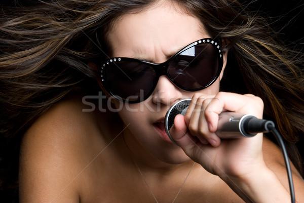 Zingen vrouw jonge vrouw bril mond zwarte Stockfoto © keeweeboy