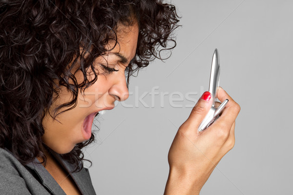 Woman Yelling into Phone Stock photo © keeweeboy