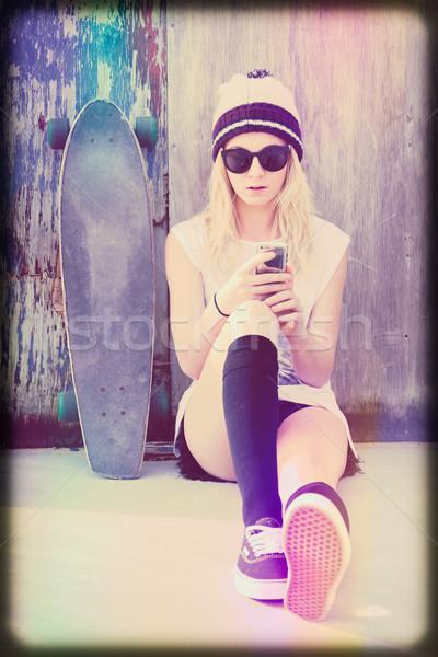 Skater Girl Texting Stock photo © keeweeboy