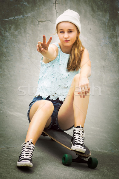 Peace Sign Skater Girl Stock photo © keeweeboy