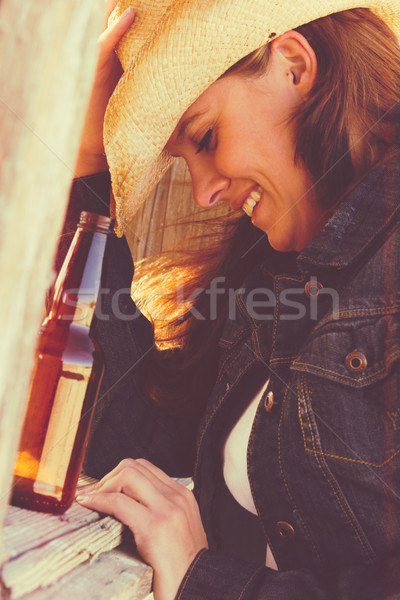 Country Girl with Beer Stock photo © keeweeboy