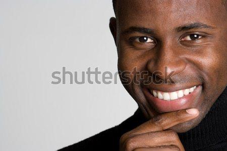 Gondolkodik férfi jóképű mosolyog afroamerikai férfi arc Stock fotó © keeweeboy